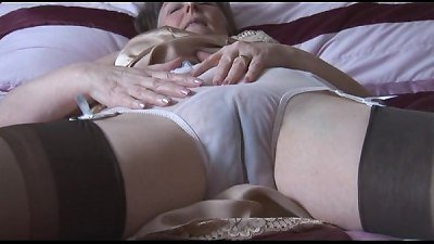 hairy grandma in glide and pantyhose with see through panties peels off